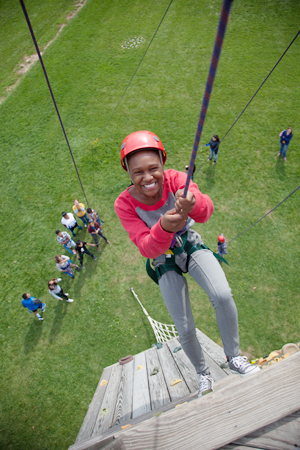 picture of girl on ropes course